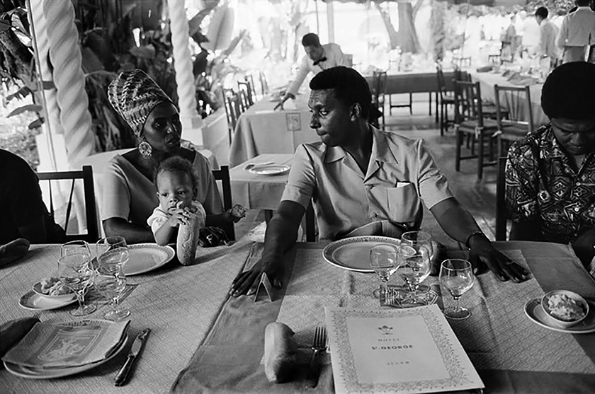 South African vocalist Miriam Makeba and Stokely Carmichael break bread in the dining room of the Hotel St. George in Algiers while participating in events at the Pan African Cultural Festival, July 1969. (Guy Le Querrec, photo)
